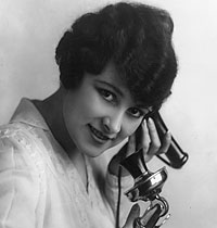 woman on old fashioned telephone